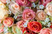 Mesterséges rose és virágot háttér