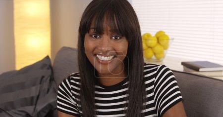 Pretty black woman smiling in striped shirt