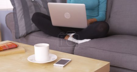 Black woman working from home on laptop