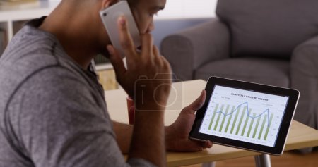 Black businessman working from home on tablet