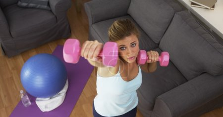 Pretty girl working out in living room