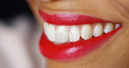 Closeup of woman smiling with red lipstick