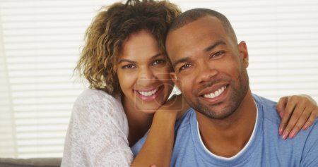Happy Black couple smiling