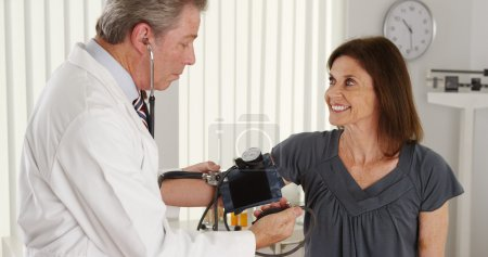 Elderly patient having her blood pressure checked
