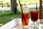 Refreshing lemon iced tea and black tea in the garden