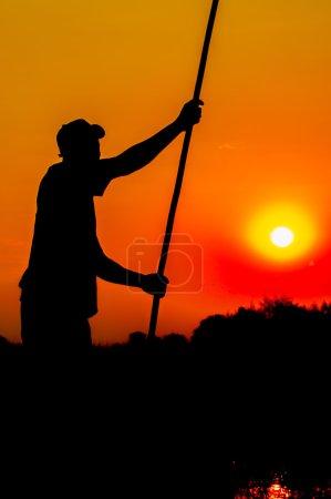 Silhouette of Poler in Okavango Delta
