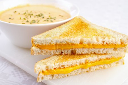 Cheese sandwiches with a bowl of soup