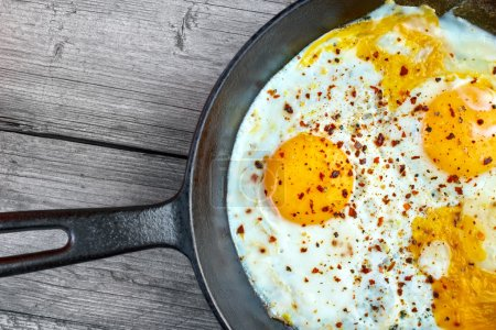 Fried eggs in cast iron frying pan