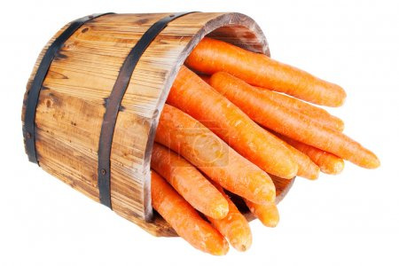 Photo for Carrots in wooden barrel, isolated on white - Royalty Free Image