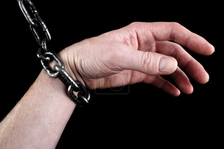 Hand in shackles
