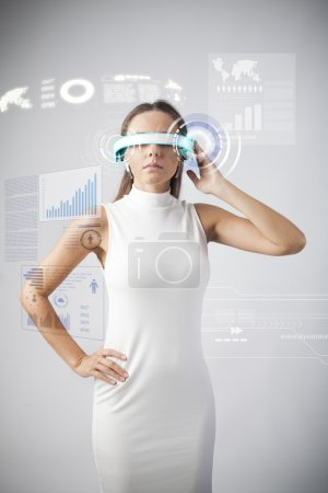 Photo for Young woman with smart-glasses front of virtual future interface - Royalty Free Image