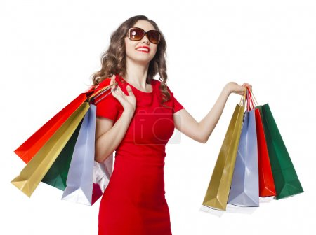 Photo for Shopping woman holding shopping bags on isolated white background - Royalty Free Image