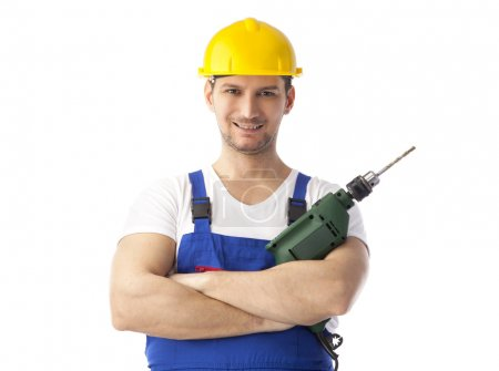 Smiling handyman holding drill machine