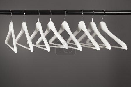 Photo for Group of empty white wooden hangers - Royalty Free Image