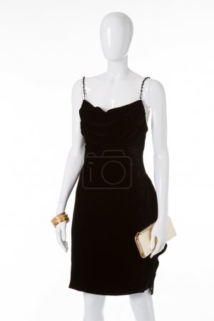 Black velvet dress on white mannequin.