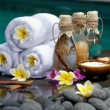 At the Spa, concept in a luxury Villa on Bali Island with, Massage oil, bath-salt, Volcanic stones, body scrub, Towels,Cinnamon sticks, Orchids and flowers.