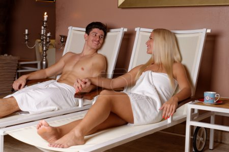 Couple relaxing after sauna