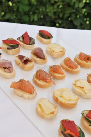 Photo pour Catering, a lot of cold snacks on buffet table - image libre de droit