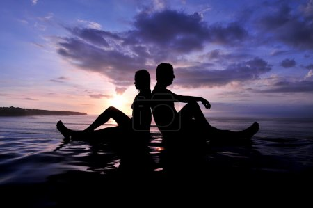 Photo for Silhouette of a young romantic couple on sunset - Royalty Free Image