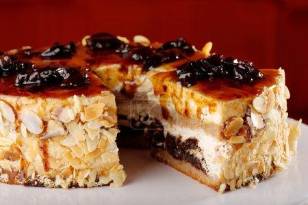 Chocolate cream brownie cake layers slice topped w...