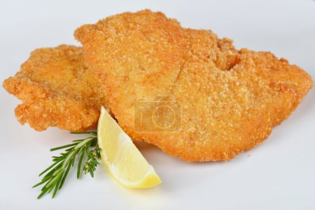 Steak Schnitzel isolated, escalope meat on the pla...