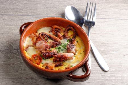 Photo for Spanish tapas with  octopus, pulpo a la gallega on table - Royalty Free Image