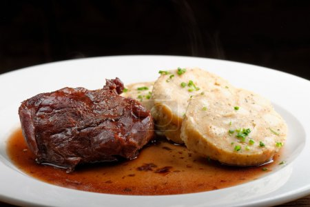 Photo for Veal fillet with rich sauce and bread dumplings - Royalty Free Image