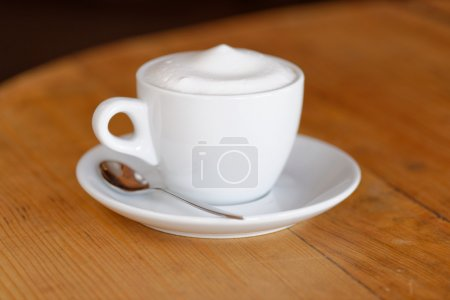 Photo for Cup of Cappuccino coffee in restaurant close up - Royalty Free Image