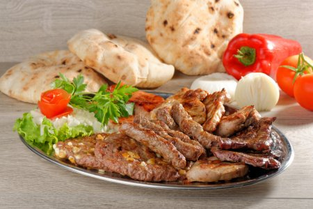 Photo for Wholesome platter of mixed meats including grilled steak - Royalty Free Image
