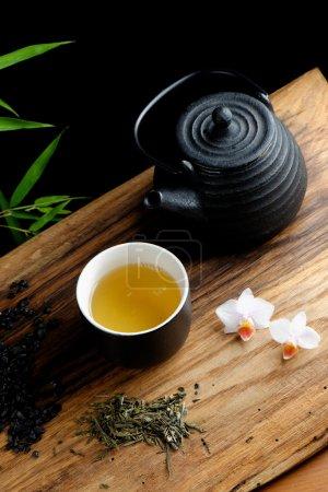 Asian tea set on bamboo mat, green tea