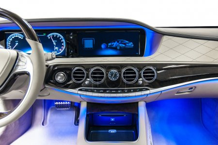 Car interior luxury dashboard with blue ambient light
