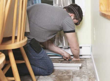 A ventilation cleaner man at work with tool