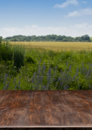 Very nice wooden table with the landscape.