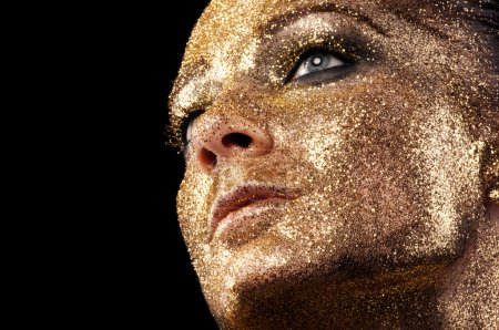 Face in gold. .