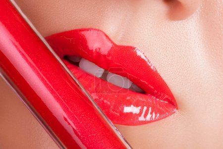 Red gloss lips. Beautiful red lips close-up....