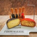 Freshly cut wax-coated cheese wheels with truffles...