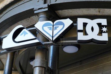 Photo pour Bordeaux, Aquitaine / France - 11 11 2020 : Quiksilver and dg roxy sign and logo front of shop surf wear building facade - image libre de droit
