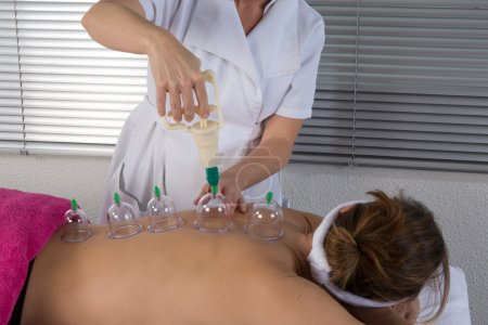 Woman getting a massage at Spa center