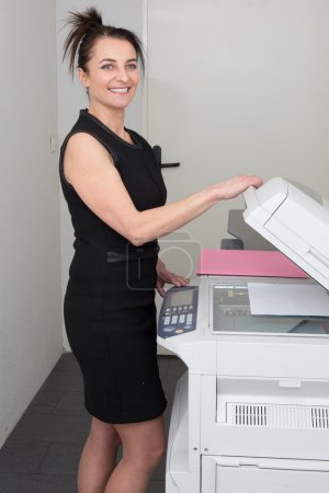 Woman at work, with a copy machine