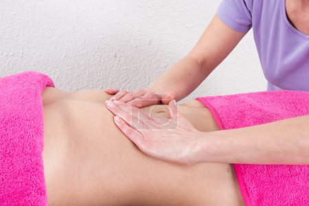 Young woman having a massage at spa center