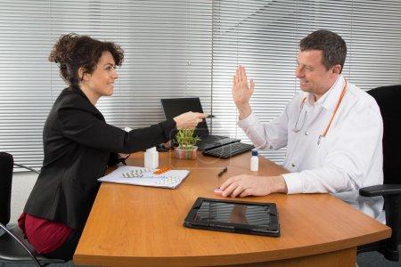 Doctor receiving a sales representant