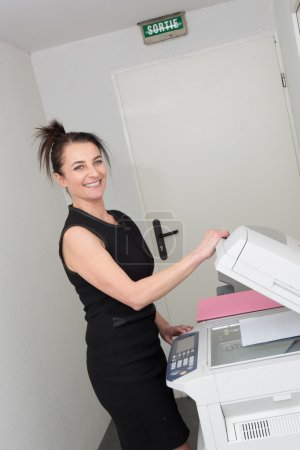 Woman at the copy machine