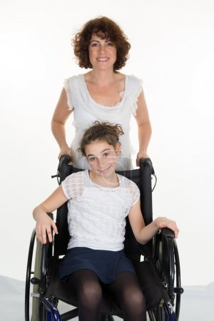 Mother Pushing Daughter In Wheelchair isolated on white