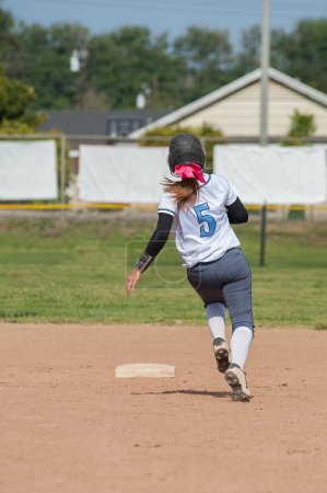 Base runner sprinting to second.