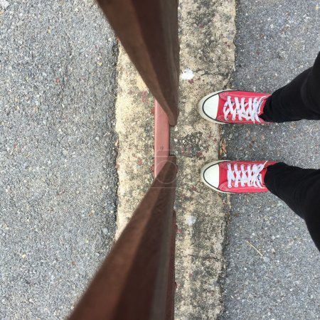 Feet From Above Concept, Teenage Person in Red Sneakers