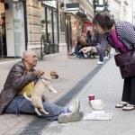 Постер, плакат: Beggar with dog