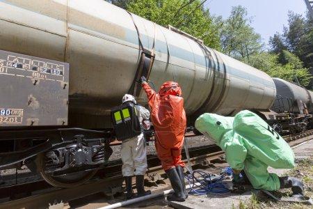 Toxic chemicals acids emergency team train crash