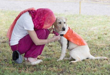 Trainer with labrador retriever guide dog