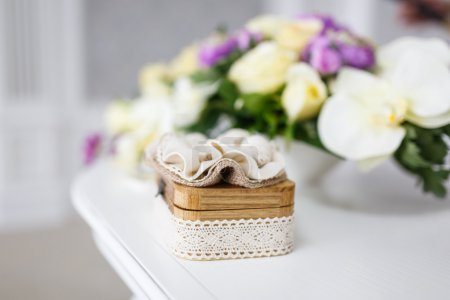 Wooden box on a background of flowers at the weddi...
