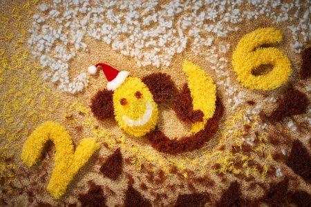 New Year 2016. Christmas.Funny monkey with banana, decoration